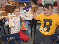 Charles Campagne Students Construct Cornhusk Dolls photo